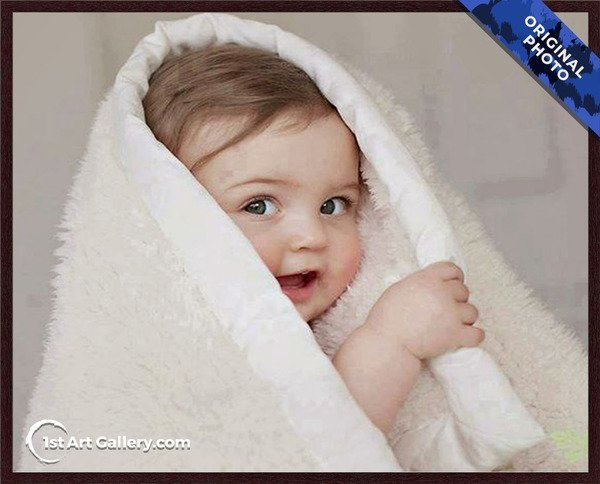 A photo of a child hiding in blanket
