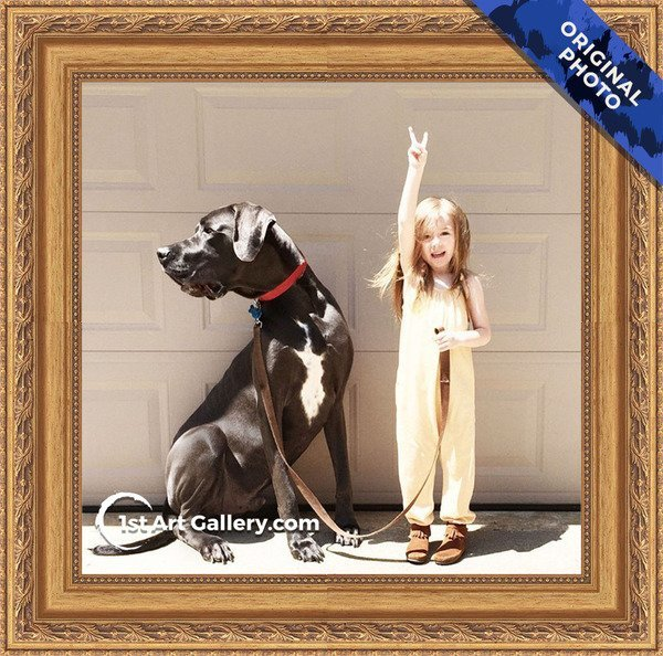 A photo of a little girl with a big dog