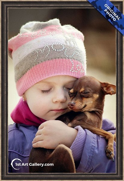 A photo of a girl hugging a pygmy chihuahua