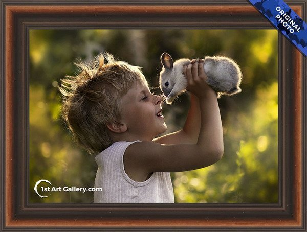 A photo of a boy playing with a bunny