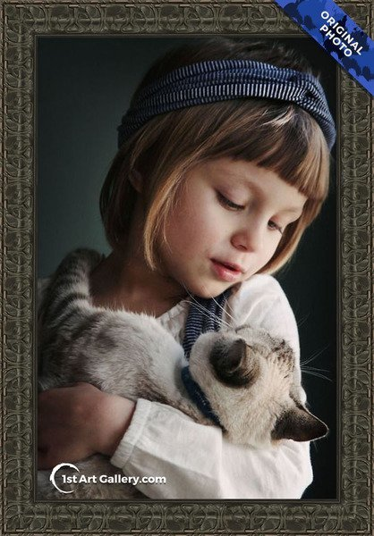 A photo of a girl holding a siamese cat