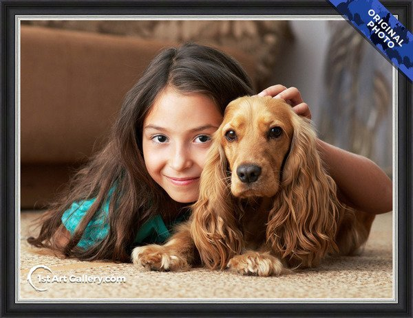 A photo of a girl with a spaniel dog