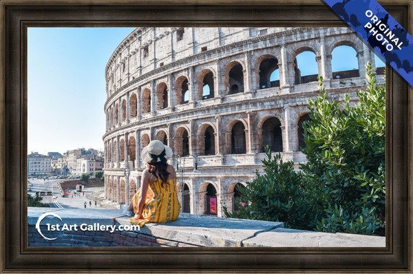 A photo of a girl sitting at the coliseum