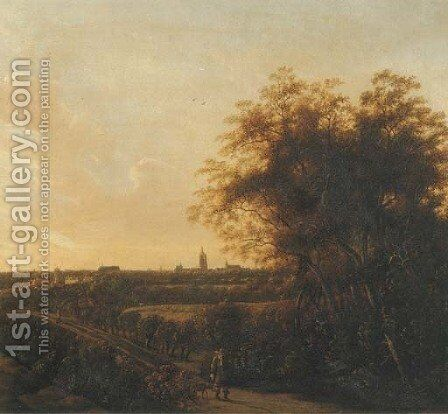A wooded landscape with a sportsman and his dog on a sandy road, a view of The Hague in the distance by Anthony Jansz van der Croos - Reproduction Oil Painting