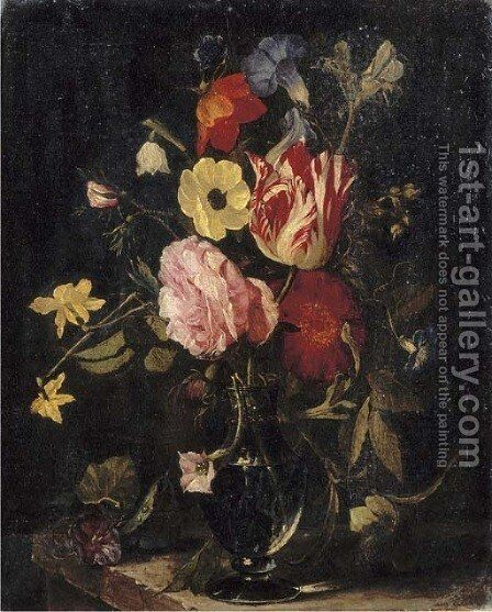 Roses, tulips, an iris, pansies and an anemone in a glass vase on a stone ledge by (after) Daniel Seghers - Reproduction Oil Painting