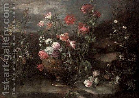 Carnations, tulips and roses in an urn in a rocky landscape by (after) Margherita Caffi - Reproduction Oil Painting