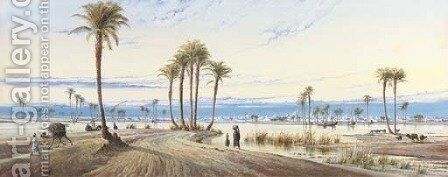 A view of the Nile with a city in the distance by Augustus Osborne Lamplough - Reproduction Oil Painting
