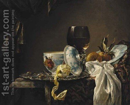 A still life of china, a goblet, fruit and a peeled lemon on a table by (after) Willem Kalf - Reproduction Oil Painting