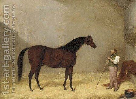 A bay hunter with a groom in a stable by Martin Theodore Ward - Reproduction Oil Painting