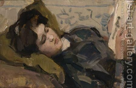A Reclining Girl Looking At A Print by Isaac Israels - Reproduction Oil Painting