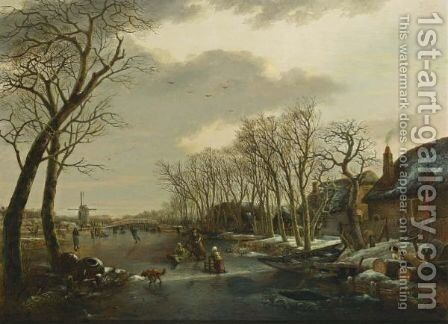 A Winter Landscape With A Woman Skating Behind A Sledge, A Girl Skating With A Chair, And Other Figures Skating And A Dog On A Frozen Canal Near A Village With A Mill Beyond by Arnoldus Van Well - Reproduction Oil Painting
